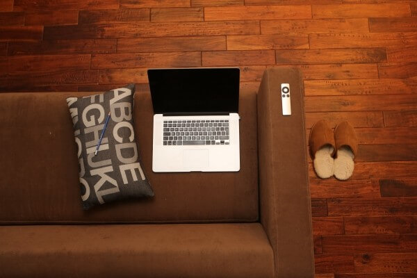 aerial-view-of-laptop-and-tv-remote-on-sofa-1