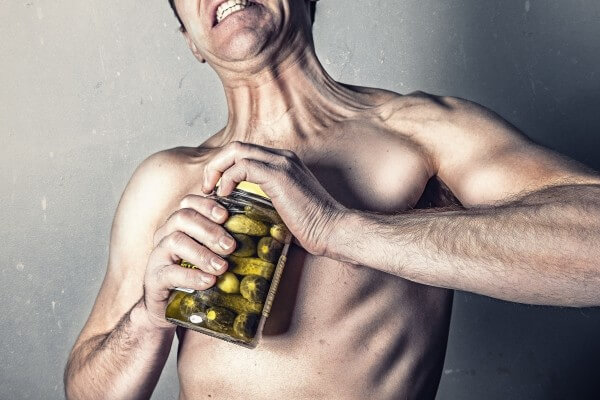 shirtless-man-trying-to-open-jar-with-pickles-1